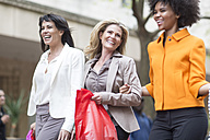 Three happy women side by side on shopping tour - ZEF006600