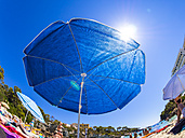 Spain, Baleares, Majorca, Cala Ferrera, blue beach umbrella - AM004042