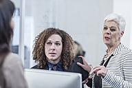 Businesspeople having meeting in board room - ZEF005605