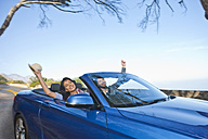 South Africa, happy couple in a convertible - ZEF005693