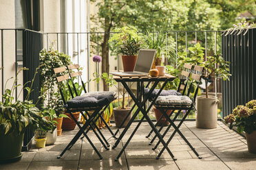 Bistro chairs and table with laptop on balcony - MFF001652