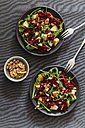 Two bowls of beetroot salad with rocket and walnuts - EVGF001835