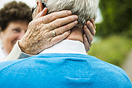 Senior woman embracing her husband, close-up - UUF004535