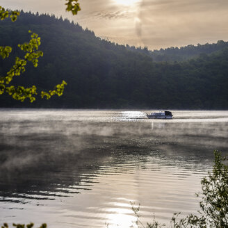 Germany, Hesse, Waldeck, Lake Edersee, boat and morning mist - MH000364