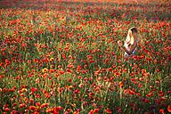 Germany, Bavaria, girl in a poppy field - YRF000082