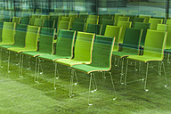 Chairs in a conference room, seeing through glass pane - TCF004689