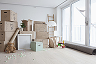 Piled cardboard boxes in flat - RBF002854
