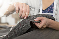 Young seamstress making a jacket - FKF001158