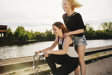 Two friends riding BMX bicycle together - GCF000113