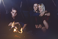 Friends sitting together at the campfire - GCF000104