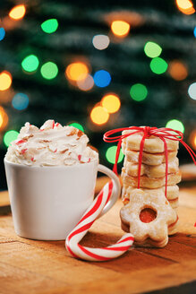 Cup of cappuccino, candy cane and stack of Christmas cookies - BZF000167