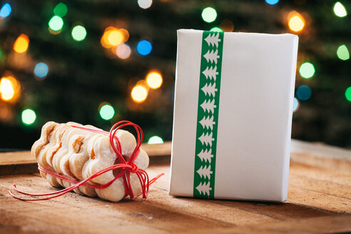 Stack of Christmas cookies and wrapped Christmas present - BZF000169