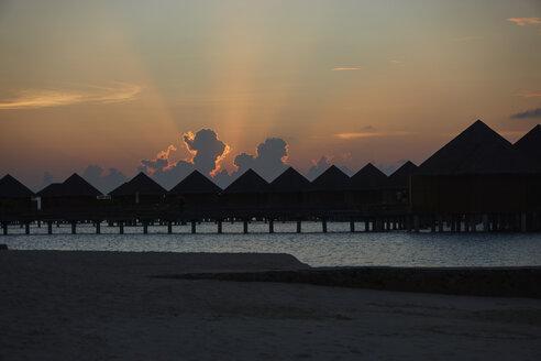 Maldives, pile dwelling resort at sunset - STKF001280