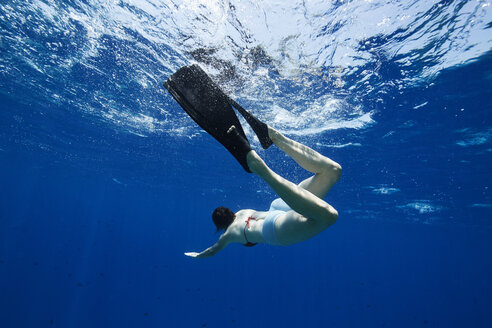Maldives, woman snorkeling in the Indian Ocean - STKF001312