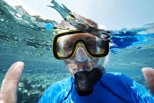Maldives, portrait of woman snorkeling in the Indian Ocean - STKF001298