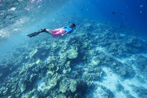 Maldives, woman snorkeling in the Indian Ocean - STKF001305