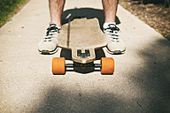 Close-up of a man with a longboard - SELF000060