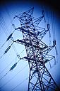 Power pylon in front of blue sky - MHCF000005