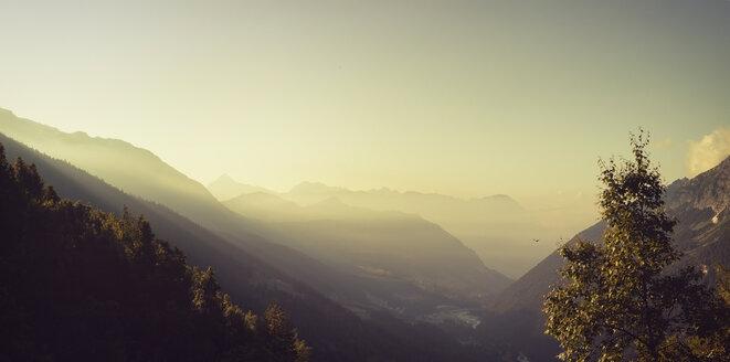 France, Lombardy, near Chiareggio, View to mountains, early-morning haze at sunrise - DWIF000526