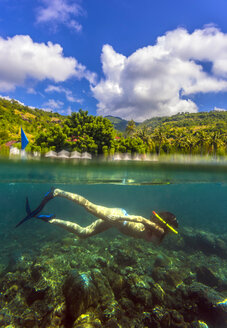 Indonesia, Bali, Amed, young woman snorkeling - KNTF000060