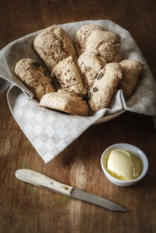 Bread basket of different home-baked whole meal spelt rolls - EVGF001882