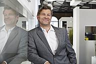 Portrait of a confident businessman in office - PDF000980