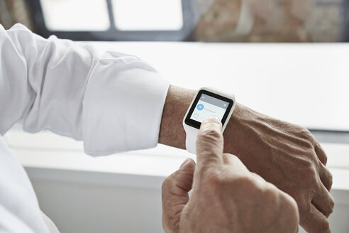 Close-up of businessman with smartwatch - PDF001072
