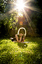 Girl lying on a meadow reading a book - LVF003496