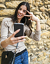 Young woman taking a selfie with her smartphone - MGOF000292