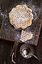 Waffles sprinkled with icing sugar on wooden board - SBDF002021