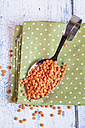 Spoon of red lentils on cloth - SBDF002029