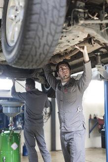 Car mechanic at work in repair garage - ZEF005680