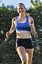 Young athlete running in rain - STSF000814