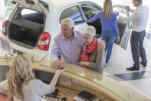 People at a car dealer in showroom - ZEF006368