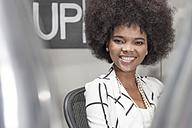Portrait of smiling shop assistant - ZEF006659