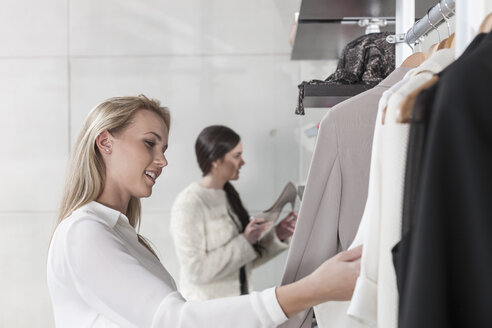 Woman shopping for clothes - ZEF006686