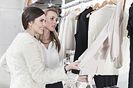 Two women shopping for clothes - ZEF006690