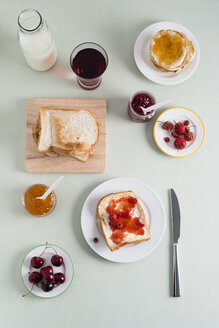 Toast with strawberry jam, toasties with apricot jam, strawberries and cherries, milk bottle - MYF001033