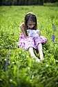 Little girl sitting on a meadow with insect can - SARF001922