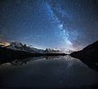 France, Mont Blanc, Lake Cheserys, Milky way and Mont Blanc reflected in the lake by night - LOMF000006