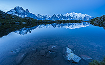 France, Mont Blanc, Lake Cheserys, Mont Blanc reflected in the lake at blue hour - LOMF000009