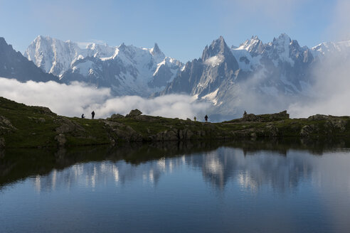 France, Mont Blanc, Lake Cheserys, hikers on the lake - LOMF000013