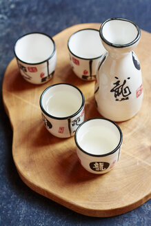 Sake set with 4 cups and a carafe, two cups filled with sake - HAWF000801