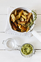 Casserolle of potato wedges with rosemary and glass of pesto - EVGF001824