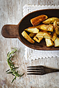 Wooden bowl of potato wedges with rosemary - EVGF001828