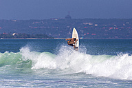 Indonesia, Bali, man surfing a wave - KNTF000132