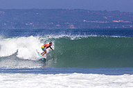 Indonesia, Bali, man surfing a wave - KNTF000133