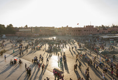 Morocco, Marrakesh, view to lighted Jemaa el-Fnaa bazaar in the evening - JUNF000322