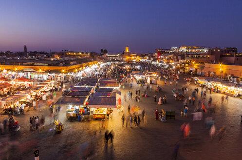 Morocco, Marrakesh, view to lighted Jemaa el-Fnaa bazaar - JUNF000323