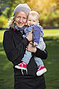 Portrait of happy mother with her little son in a park - TAM000144